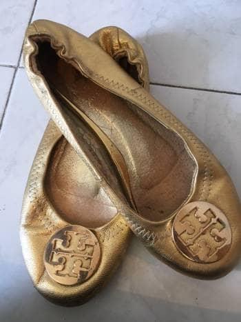Flats dorados tory burch